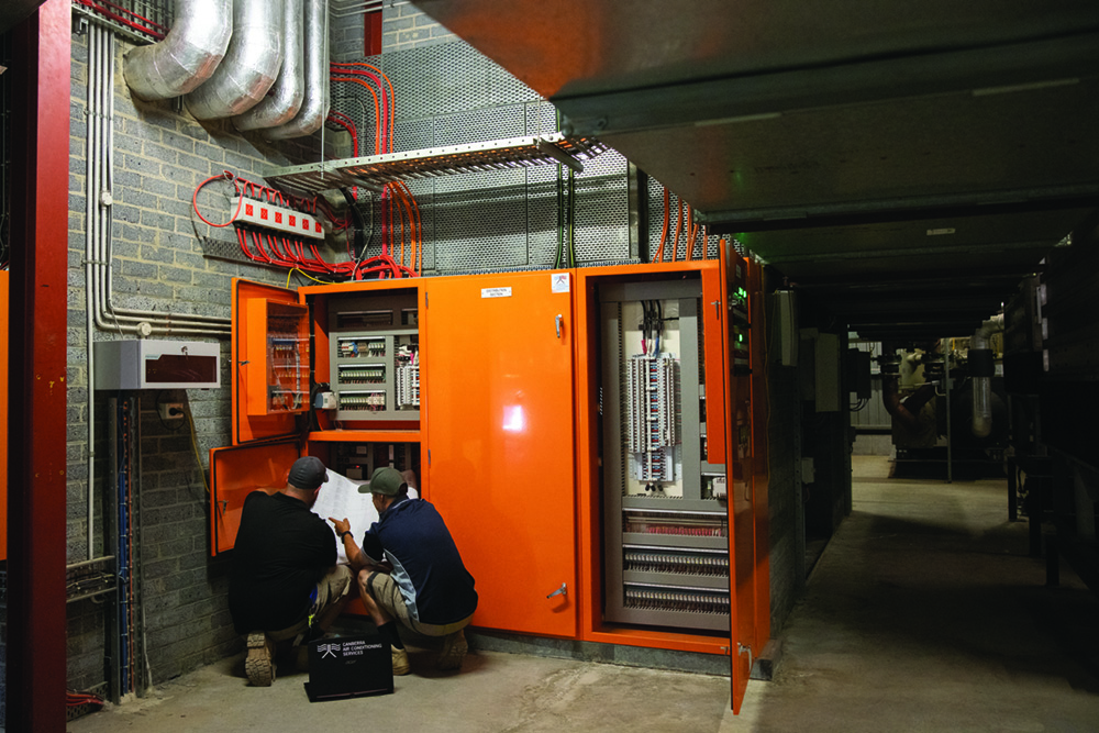 CACS team working on a Canberra air conditioning project
